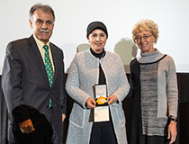 Associate professor of earth and ocean sciences Eman Ghoneim (center) received the Board of Trustees Teaching Excellence Award. She is pictured with Chancellor Jose V. Sartarelli and Provost Marilyn Sheerer.