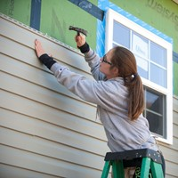 UNCW School of Nursing student participating in Habitat for Humanity