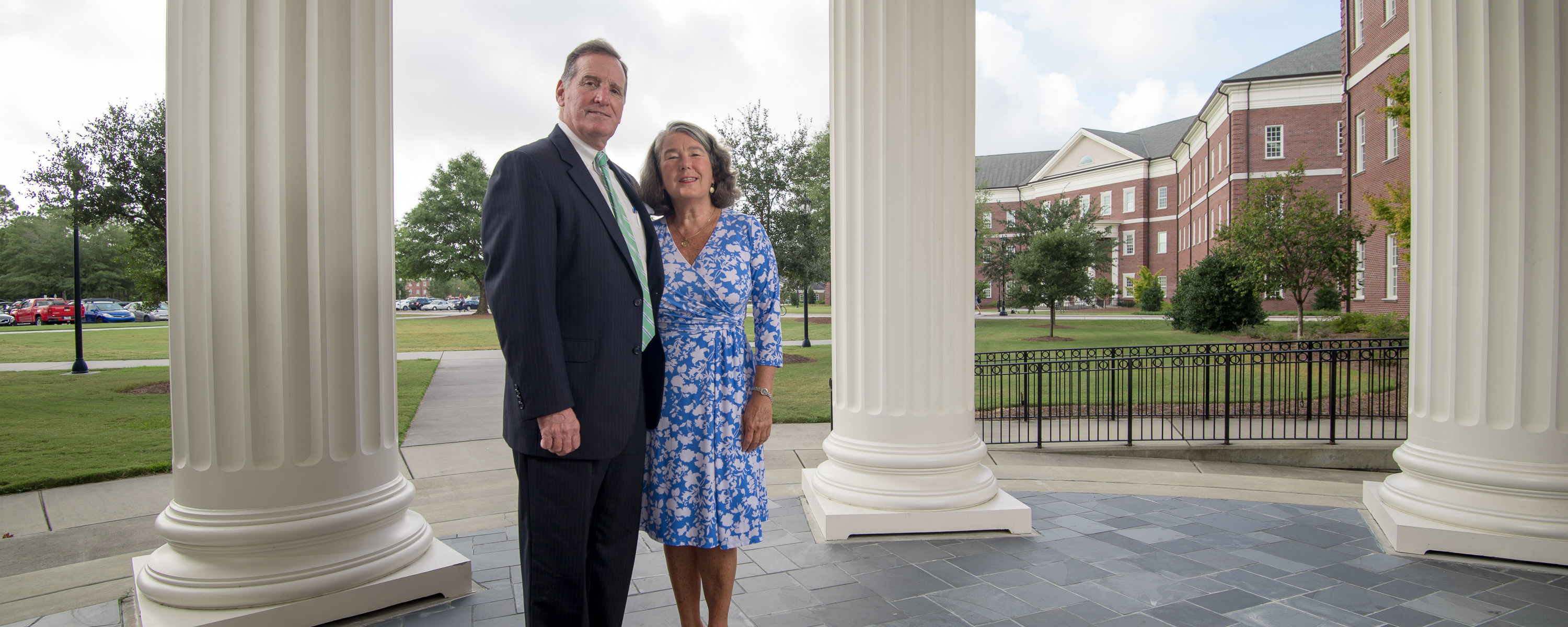 Steve and Louise Coggins stand near McNeill Hall