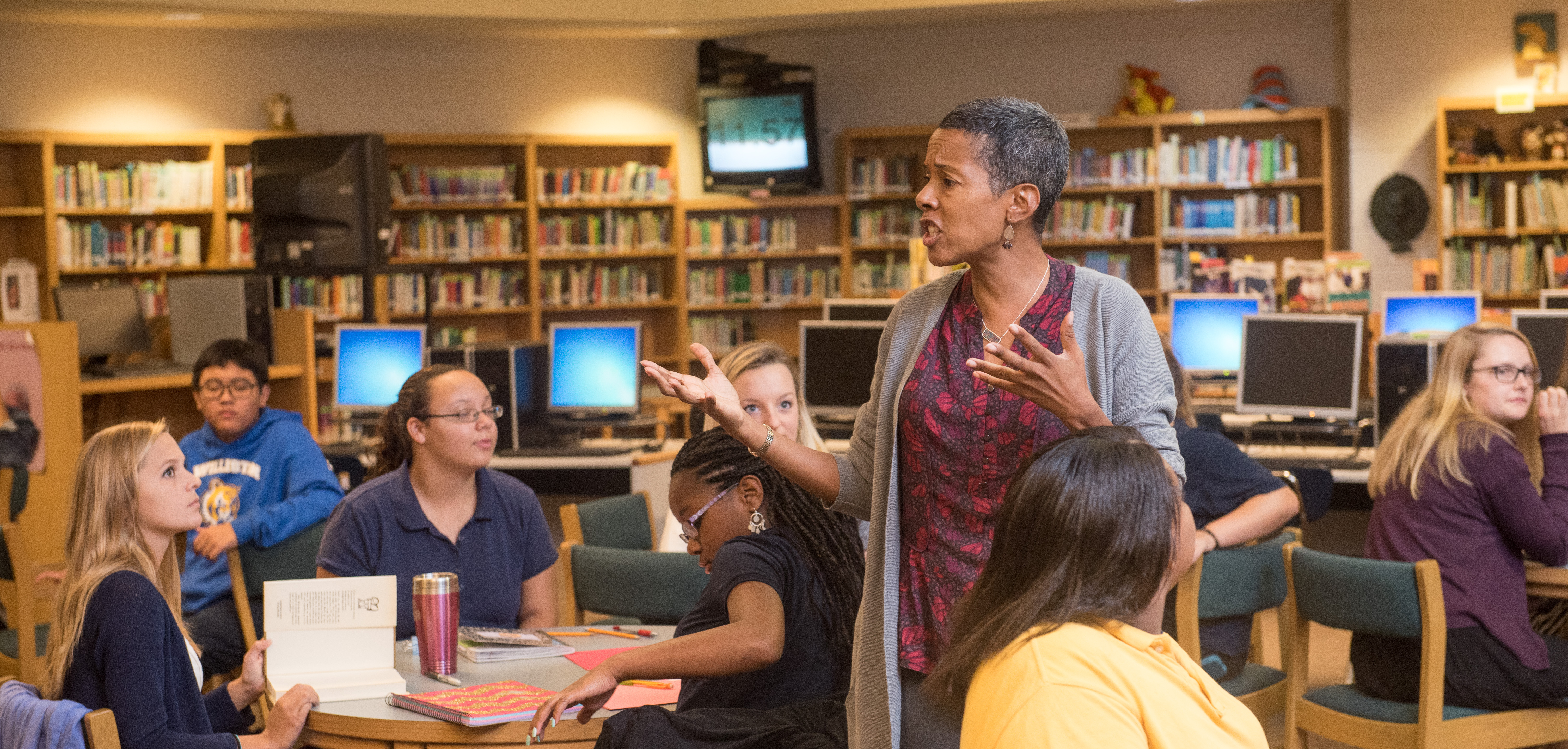 Dr. Candance Thompson, Watson College of Education professor charges her EDN 200 students and their Williston Middle School poets as they begin the creative process to learn the Poetry Slam.