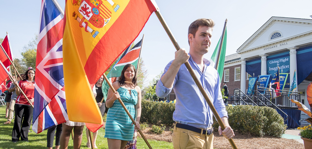 students carry international flags