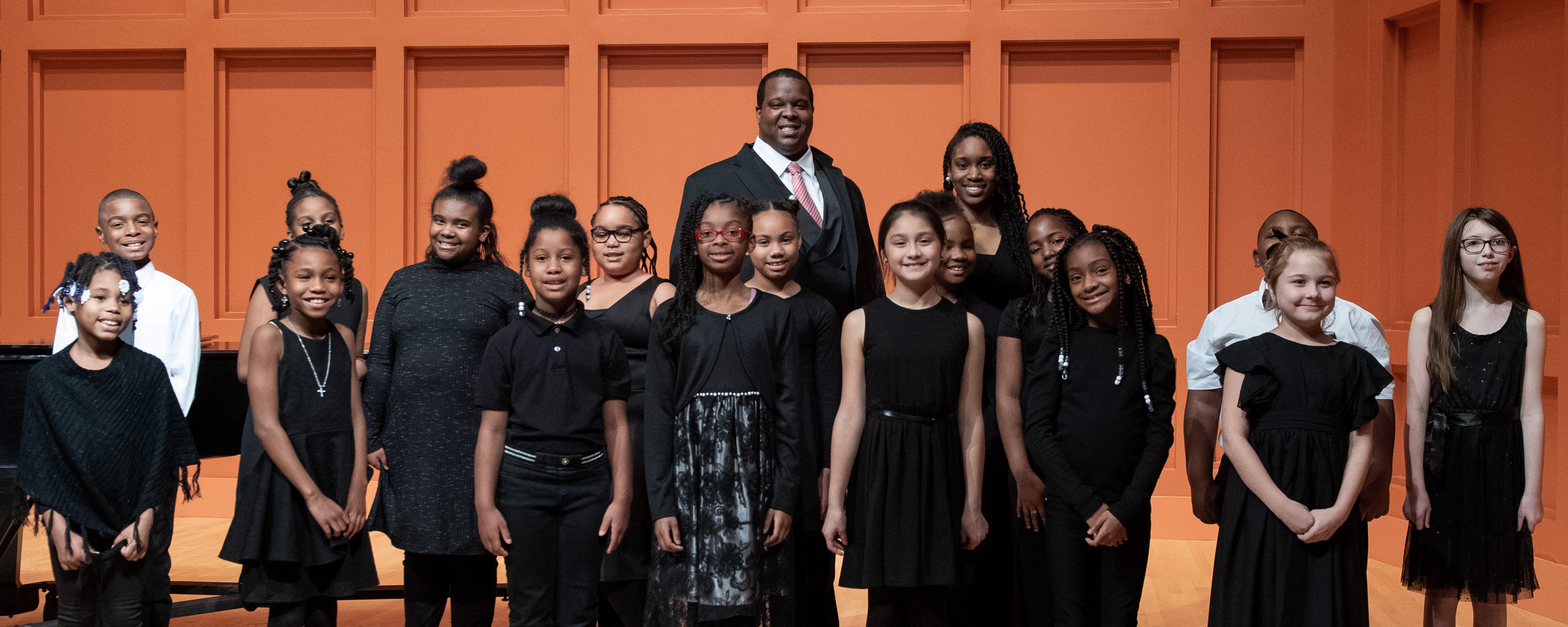 Joshua Conyers and student choir on stage