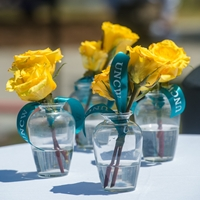Roses honoring the lives of four UNCW staff members who passed away