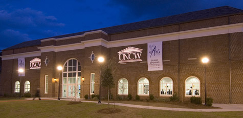 Night photo of building on UNCW campus