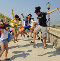 Students jumping at the beach