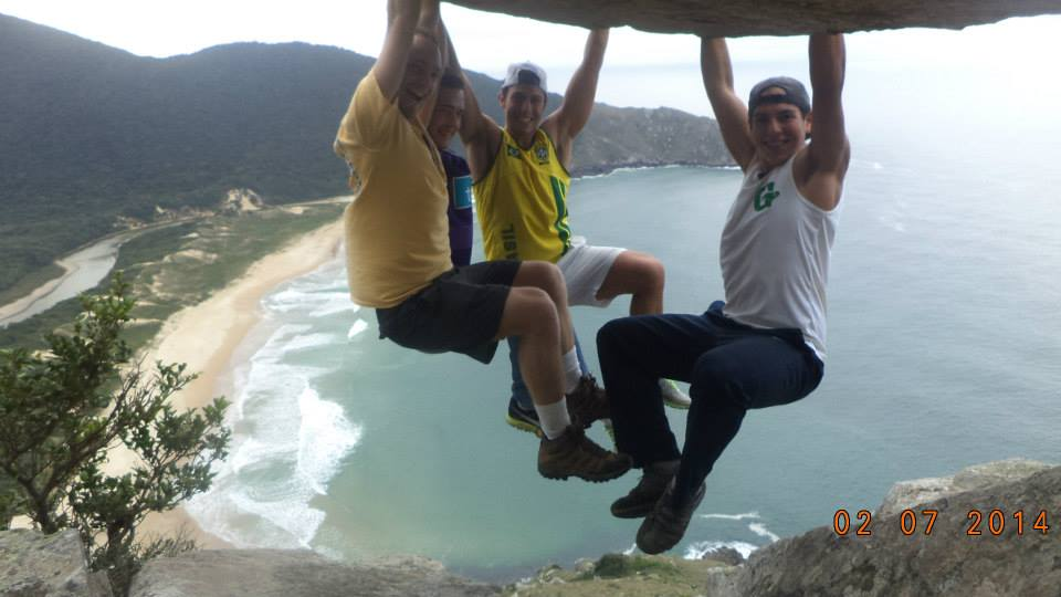 students hanging from a rock