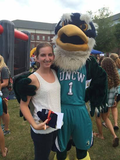 Student with Sammy the Seahawk