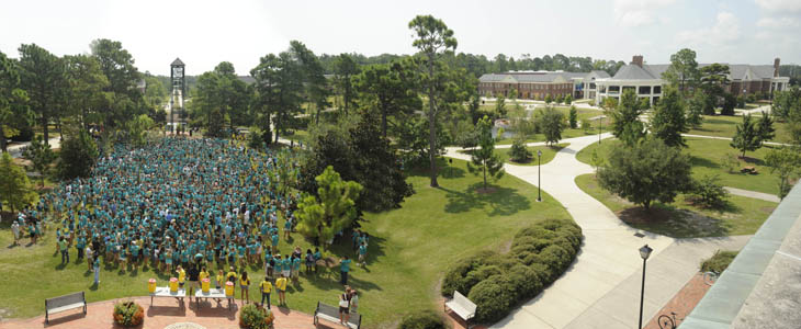 UNCW students gather near the Amphitheatre during convocation