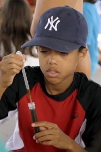 student using pipet