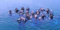 teen scuba camp partipants at surface of water