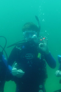 student giving ok while diving