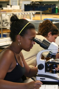 girl working with microscope