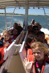MarineQuest Summer Camp students on a boat