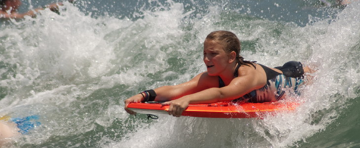 student boogie boarding