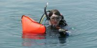 teen scuba diving camp participant at surface
