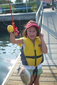 Marine Science Summer Camp girl with fish