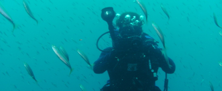 Student taking underwater picture
