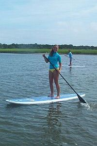 UNCW MarineQuest Marine Biology and Surfing Camp girl stand up paddleboarding