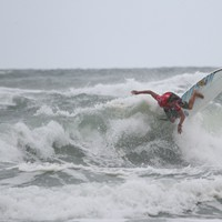 UNC Wilmington Surf Team member Tony Silvagni completes a snap turn during his event.