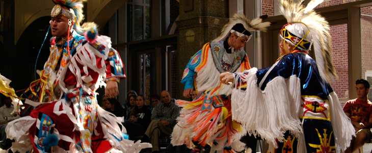 Three Native Americans dancing at a Powwow
