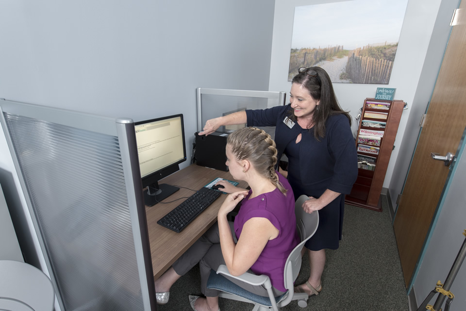 Onboarding Specialist assisting New Employee