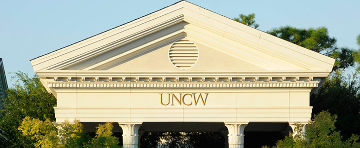 Picture of UNCW Campus with House Logo