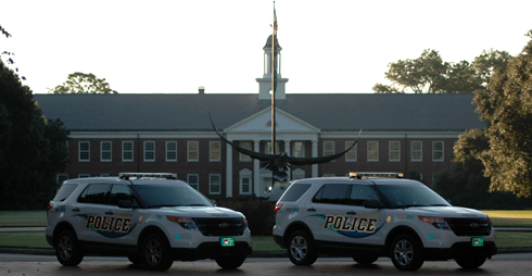 UNCW police cars parked in front of Seahawk Statue