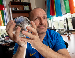 Herbert Berg holding a glass globe in his hands