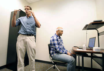 Julian Keith demonstrating neurofeedback in the Teaching Lab Building UNCW
