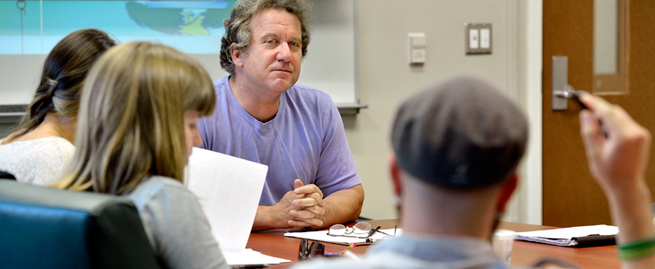 Professor Michael White meets with creative writing students.
