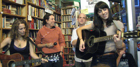 People in a bookstore with guitars